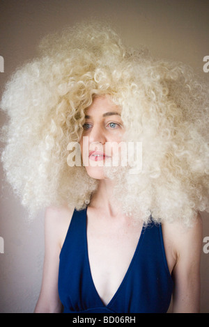 portrait of 70's woman with wild blond curly hair - Stock Photo