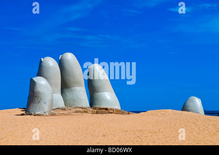 the Hand a famous sculpture in Punta del este Uruguay - Stock Photo