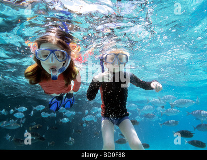 Boy and girl snorkeling - Stock Photo