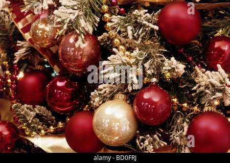 Christmas ornaments on a snowy tree - Stock Photo