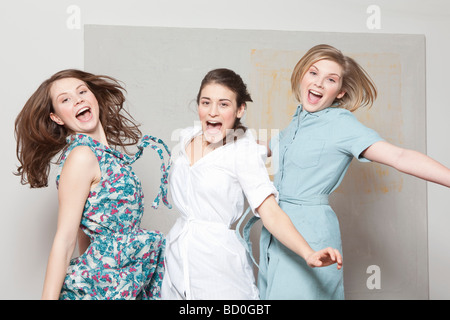 Three women jumping and jubilating