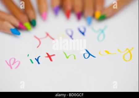 Happy birthday and colouring pencils - Stock Photo