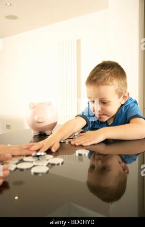 boy grabbing money