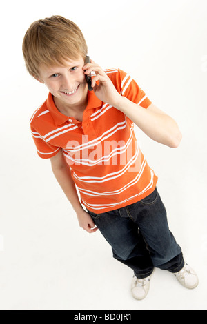 A 12 Year Old Boy Standing By A Swimming Pool Stock Photo