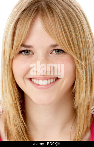 Studio Portrait Of Smiling Teenage Girl - Stock Photo