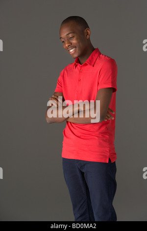 Teenage Boy Standing In Studio - Stock Photo