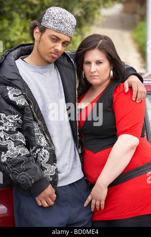 Young Couple Standing Next To Car - Stock Photo