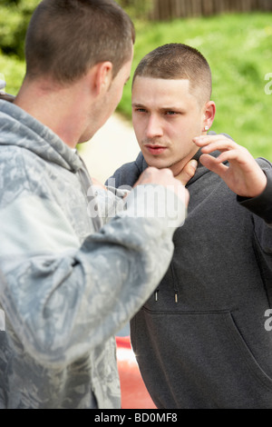 Two Young Men Fighting - Stock Photo