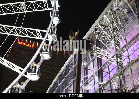 Ferris wheel windmill Exchange Square Manchester England UK at night - Stock Photo