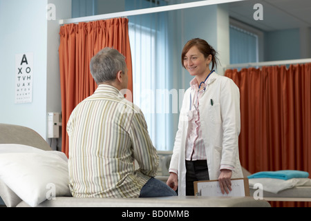 Doctor talking to patient - Stock Photo