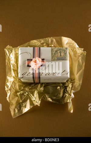 Gift being unwrapped - Stock Photo