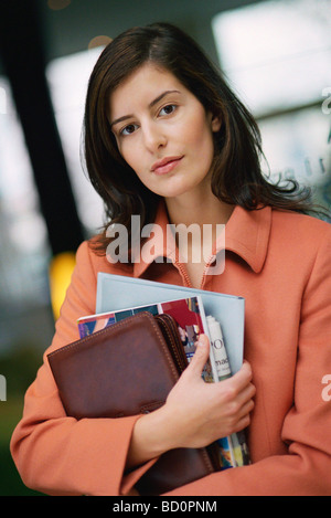 Businesswoman looking at camera, portrait - Stock Photo