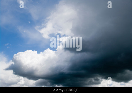 Black Rain Clouds Against Blue Sky - Stock Photo