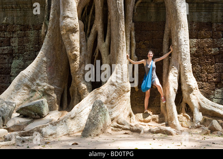 Ta Promh temple at Angkor, Cambodia overgrown with tree roots - Stock Photo