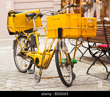 Postmans bicycle Deutsche Post, Germany, Europe - Stock Photo