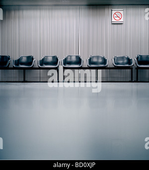 airport seats in waiting area - Stock Photo