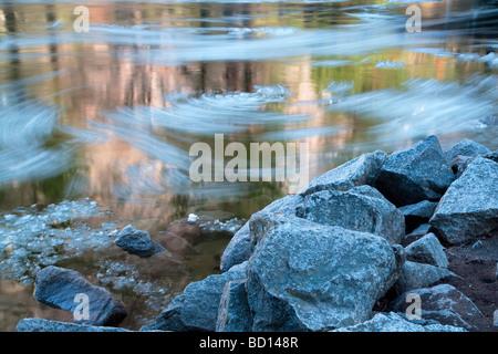 Ice breaking up in spring Merced River Yosemite National Park California - Stock Photo