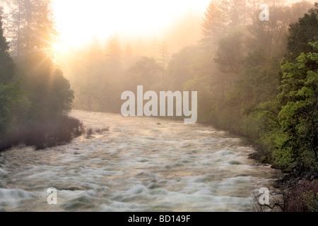Sunrise on the Merced River Yosemite National Park California - Stock Photo