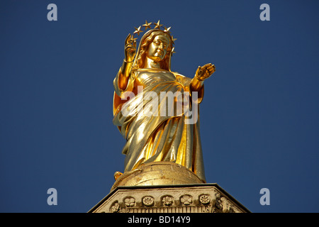 Gilded statue of Saint Mary, on the roof of the cathedral of Avignon, Provence, France, Europe - Stock Photo