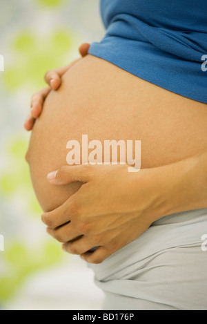 Woman's pregnant belly, side view - Stock Photo