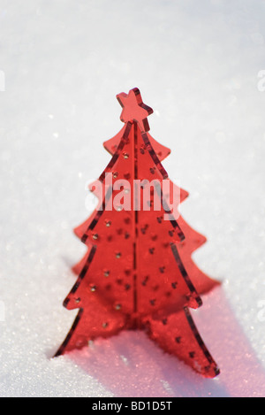 red plastic christmas tree decoration set in snow stock photo - Plastic Christmas Tree