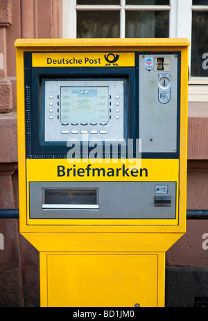 Deutsche Post machine selling stamps in Germany Europe - Stock Photo
