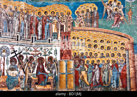 Mural detail of The Last Judgment at Romania's Voronet Painted Monastery of Bucovina - Stock Photo