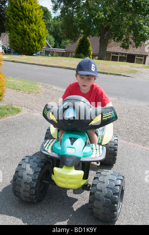 A Three Year Old Boy Driving A Battery Powered Car Stock Photo