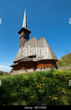 Wooden orthodox Church at Barsana Monastery complex in Romania's Maramures County - Stock Photo
