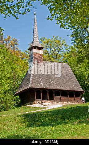 Romania's Museum of Traditional Folk Civilization wooden church from Bezdad Salaj region at Sibiu in Transylvania - Stock Photo