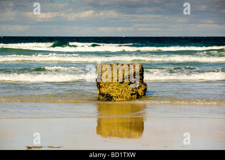 Solitary rock on the beach at Traigh Ghearadha on the east coast of Lewis in the Outer Hebrides of Scotland - Stock Photo