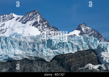 Bertrab hanging glacier clings to rockface at Gold Harbour South Georgia Antarctica - Stock Photo