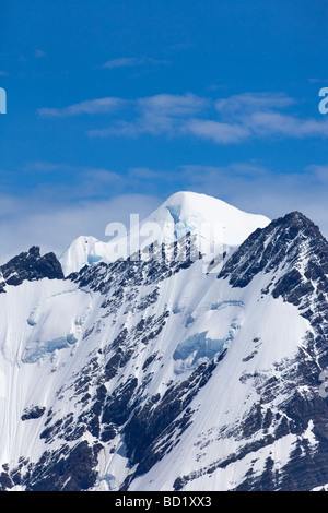 Mountain peaks and glaciers behind Gold Harbour South Georgia Antarctica - Stock Photo