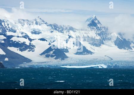 Salvesen Range mountains and Fortuna Glacier tidewater melting into Cumberland Sound South Georgia Antarctica - Stock Photo