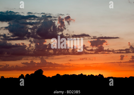 Dawn / sunrise / first light with Cumulus and Altocumulus clouds - Indre-et-Loire, France. - Stock Photo