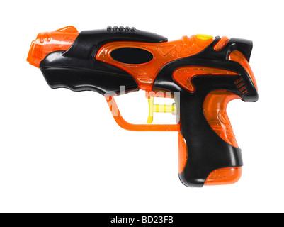 orange and black water gun - Stock Photo