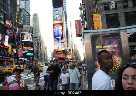 Broadway in Manhattan's Theater District, is always crowded. - Stock Photo