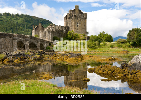 Eilean Donan Castle reflected in Loch Duich Highlands on a sunny day in Scotland July 2009 - Stock Photo