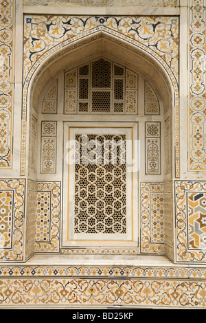 Arched and screened stone carved marble window of Itmad-ud-Daulah's Tomb mausoleum. Agra. India. - Stock Photo
