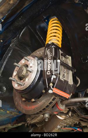 High performance brake caliper rotor on modified car - Stock Photo