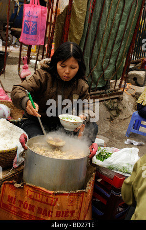 seller preparing noodle for sale in old Quarter, Hanoi, Vietnam. - Stock Photo