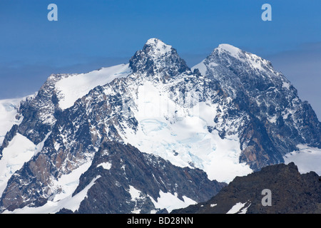 Mountain peaks behind Gold Harbour South Georgia Antarctica - Stock Photo