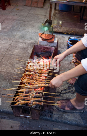 BBQ chicken leg vender in old quarter, Hanoi, vietnam. - Stock Photo