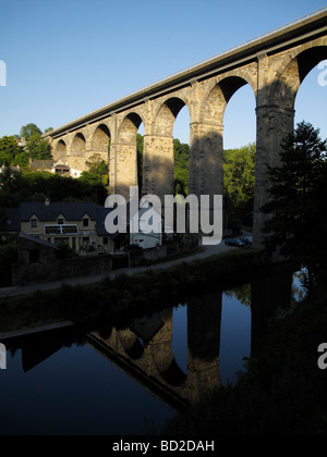 A viaduct over the River Rance in the Medieval town of Dinan in Brittany France - Stock Photo