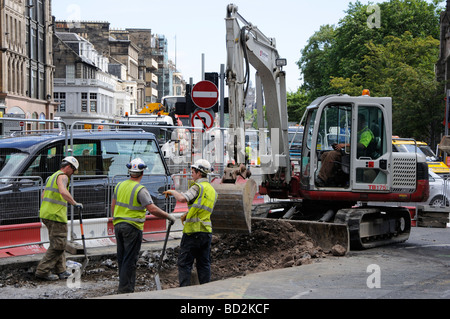 Tram workers on Princes Street, Edinburgh, Scotland, UK. - Stock Photo