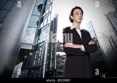 Businesswoman in city setting - Stock Photo