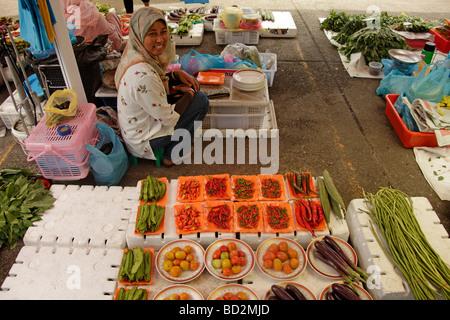 saleswoman on the market in the capital city Bandar Seri Begawan Brunei Asia - Stock Photo