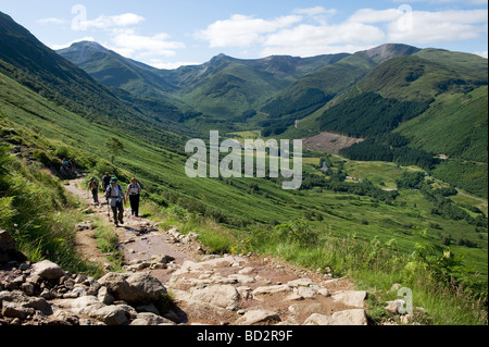 FORT WILLIAM INVERNESSSHIRE Walkers at the foothills of Ben Nevis with blue skies and fluffy clouds on a clear day - Stock Photo