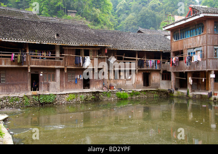 Typical wooden buildings characterize a Dong Village Zhaoxing Guizhou Province China - Stock Photo