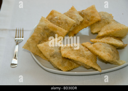 Cypriot style pastry filled with deep fried mince meat - Stock Photo